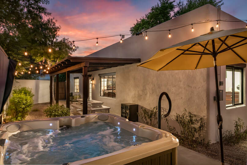 Enjoy a dip in the hot tub in this beautiful, well lit, backyard.