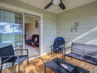 Screened porch with seating area and fabulous view!