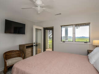 Master bedroom access to open deck with smart tv
