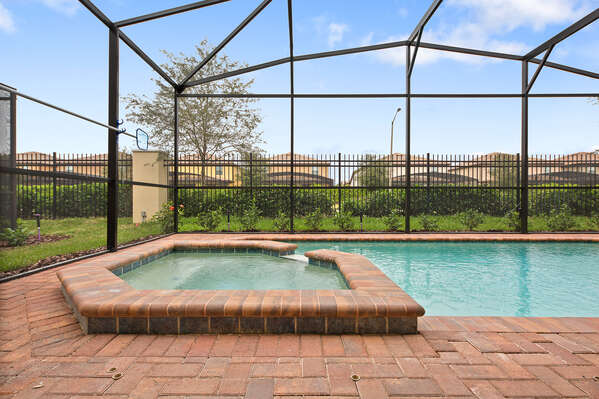 Cool off in your own private pool and spillover spa