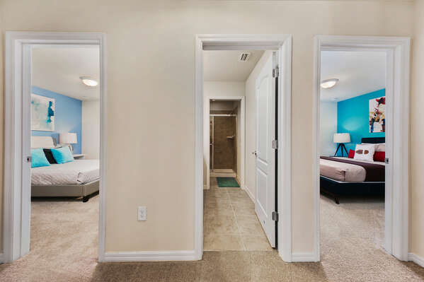 These 2 bedrooms share access to  a bathroom