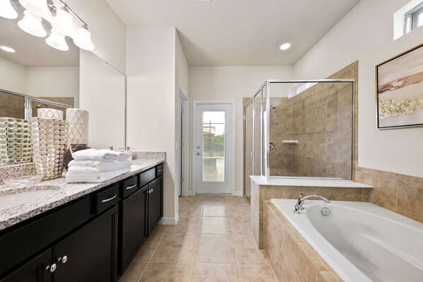 The beautiful ensuite bathroom has a garden tub and walk-in shower