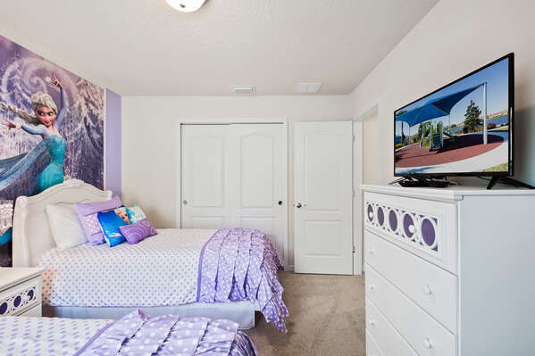 Featuring a twin and full sized bed and TV