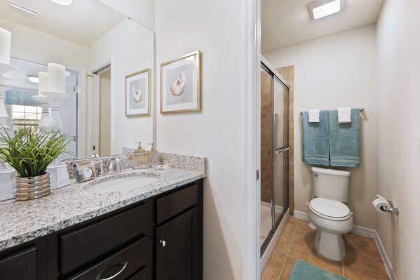 Get ready for the day in this spacious bathroom