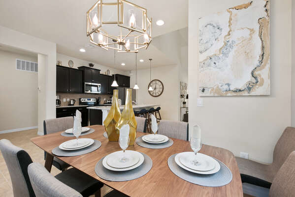 The formal dining table has seating for up to 6 guests