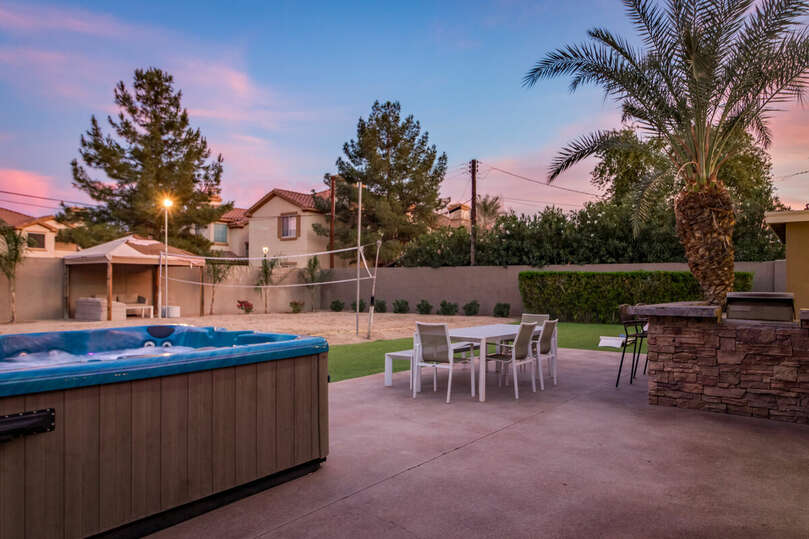 Enjoy the Arizona sunsets in this beautiful backyard, with a hot tub, volleyball court, gazebo, and plenty of lighting.