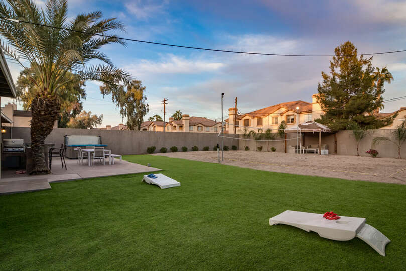 Enjoy cornhole in this spacious backyard with volleyball, hot tub, BBQ, gazebo, and, more.