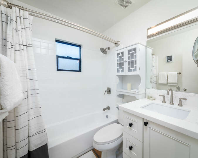 Full bathroom with a modern, white look.