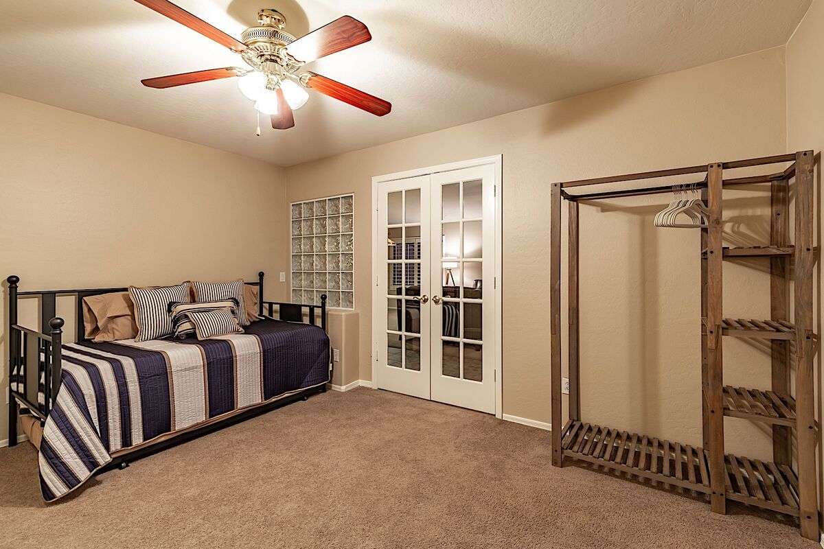Office space with trundle bed and clothing storage