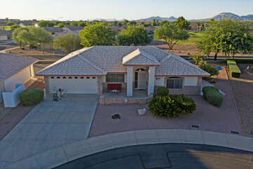 Home Is situated on a quiet cul de sac with citrus trees and a well manicured yard.