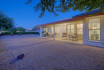 Backyard provides a secluded spot to wine and dine with family or friends.