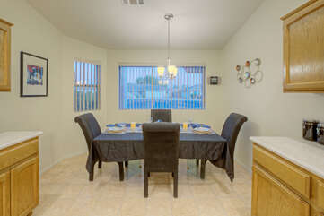 Dining area features padded chairs for your dining pleasure and comfort.