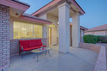 Front entrance offers yet another place to enjoy outdoor seating or a chance meeting of the neighbors.