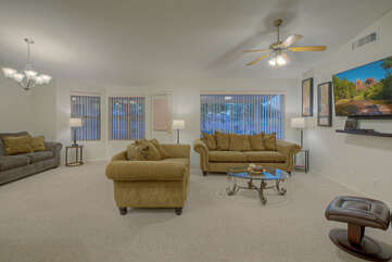 Spacious great room has generous seating for all to binge watch their favorite shows on the large TV.