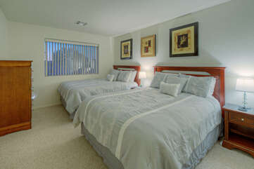 The second bedroom has 2 queen beds and a TV for your overnight comfort.