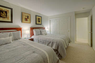 The two queen beds in the second bedroom are divine for cat naps or overnight dreams.