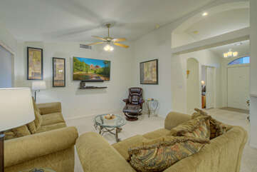 Great room is arranged for friendly chats and television viewing.