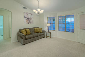 Home's large windows add natural light and enhance the overall ambiance of the living spaces.