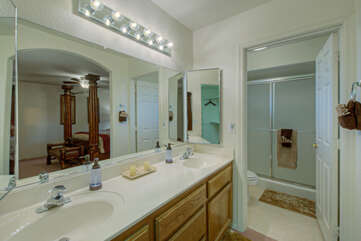 Enclosed water closet with walk-in shower adds extra layers of privacy to the primary suite.