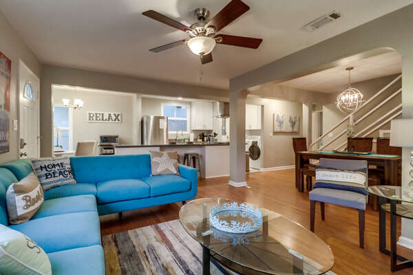 Sectional Sofa, Arm Chair, Coffee Table, Dining Set, and the Kitchen.