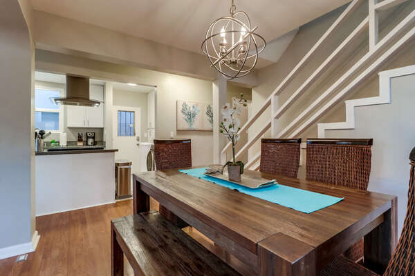 Dining Table, Chairs, Ceiling Lamp, Staircase, and the Kitchen.