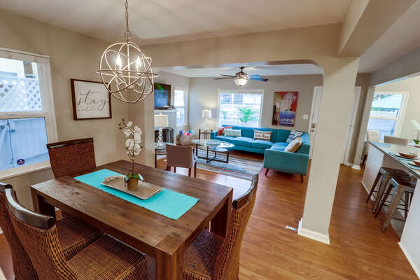 Dining Table, Chairs, Sectional Sofa, TV, and Ceiling Fan.