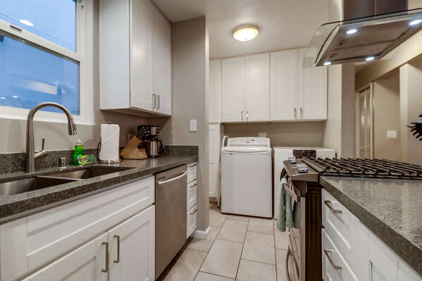 Kitchen with Coffee Maker, Dishwasher, Washer, and Dryer.