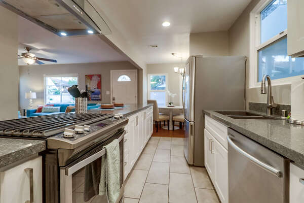 Kitchen with Dishwasher, Refrigerator, Breakfast Table and Chairs.