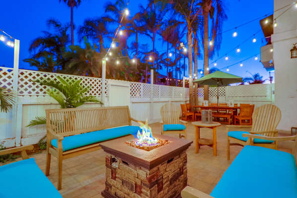 Front Patio with Seating Set, String Lights and Fire Pit.