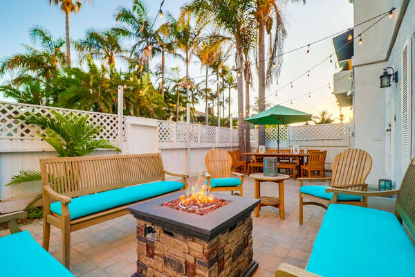 Front Patio with Seating Set, Fire Pit, and Patio Umbrella.