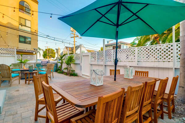 Outdoor Dining Table, Chairs, and Patio Umbrella on the Front Patio.