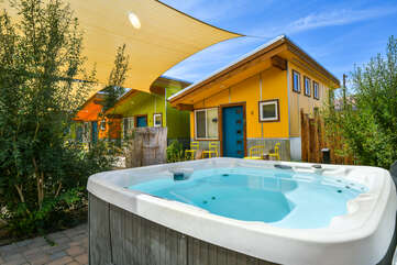 Shared hot tub with a home in the background.