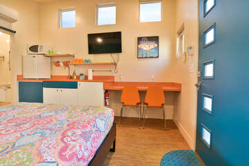 Kitchenette as seen from the bed in this Kokopelli West Moab rental.