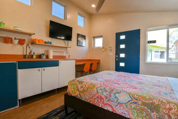 Kitchenette and bed in this Kokopelli West Moab rental.