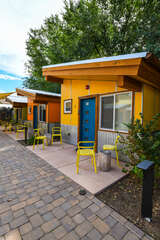 The yellow exterior of one of the Moab homes in this community.