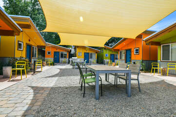 Image of the Shared Patio with tarp sun shield and ample seating.