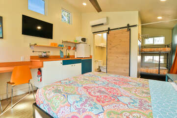 Studio View of this Moab vacation rental showing the kitchenette, bed, and bunkbed.