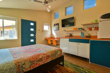 Kitchenette of this Moab vacation rental with a unique blue color scheme and TV above the sink.