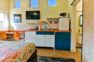 Kitchenette located in the bedroom of unit