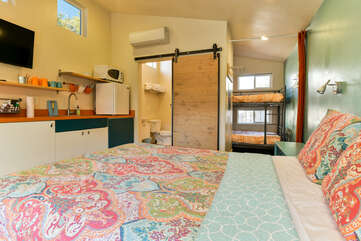Studio View with large bed and kitchenette