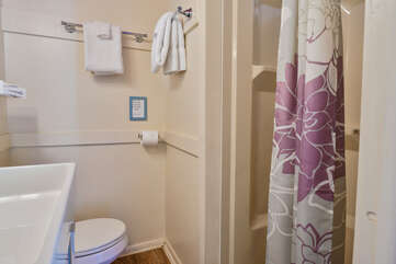 Shower and Bathroom with Floral Shower Curtain