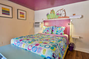 Colorful Bed with Painted Walls at Moab Places to Stay
