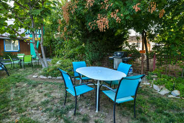 Shared outdoor dining with table and chairs