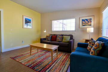 Living Room with Colorful Rug at Moab Vacation Rental