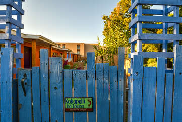 Blue Fence Entrance to Kokopelli Inn Towner