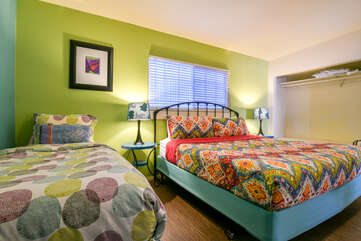 Bedroom with Colorful Comforters at Kokopelli Inn Towner #3
