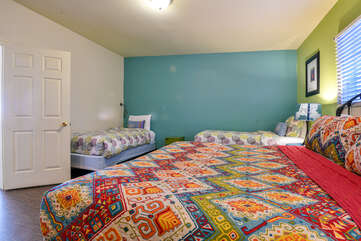 Bedroom with Three Beds at Lodging in Moab Utah Area