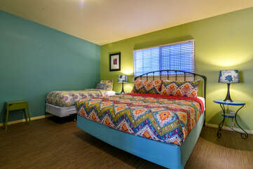 Bedroom with Colorful Beds at Lodging in Moab Utah Area