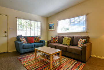 Living Room with Colorful Rug and Couches at Lodging in Moab Utah Area
