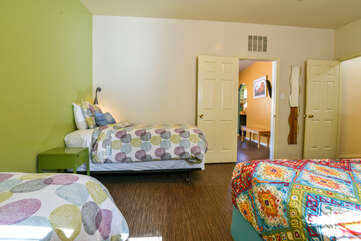 Bedroom with 2 twin beds and king bed